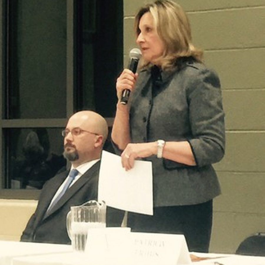 Ward 4 Alderman Pat Fribis, right, introduces herself at last week's mayoral forum in Sunset Hills. Also pictured is mayoral candidate Gregory Nelson.