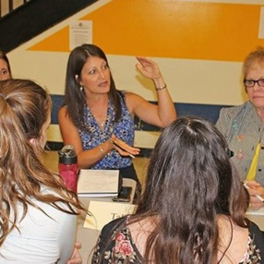 Board Secretary Lisa Dorsey, center, talks with residents with Assistant Superintendent Tina Plummer and board Vice President Jean Pretto, right, at the first open-dialogue session in September.