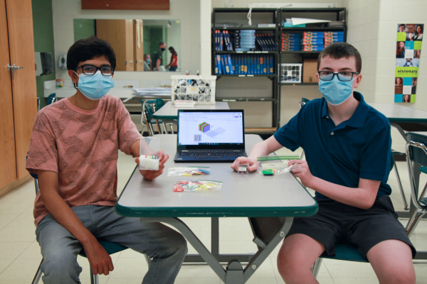 Lindbergh High School students, left to right, Biraj Pokhrel and Dylan Rice will send their science experiment to space as part of the global Cubes in Space program.