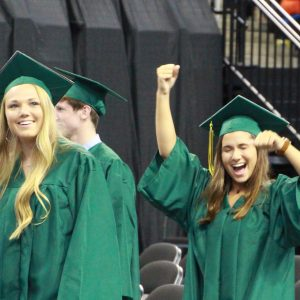 Lindbergh 2019 graduates Alexis Davis and Annabella Davis make their way into Chaifetz Arena for the ceremony.