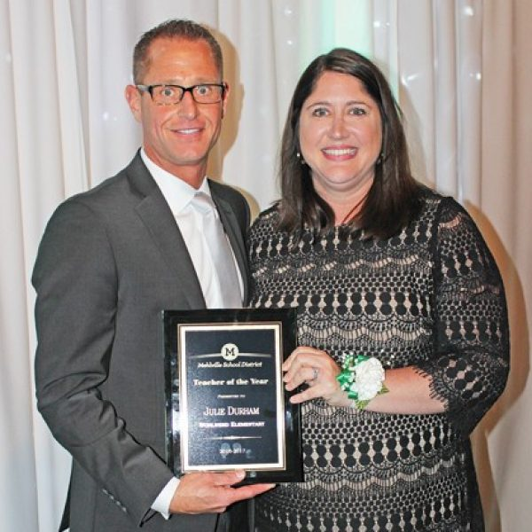 Mehlville School District Teacher of the Year Julie Durham is pictured with Assistant Superintendent Jeff Bresler at the district's annual Recognition Night.