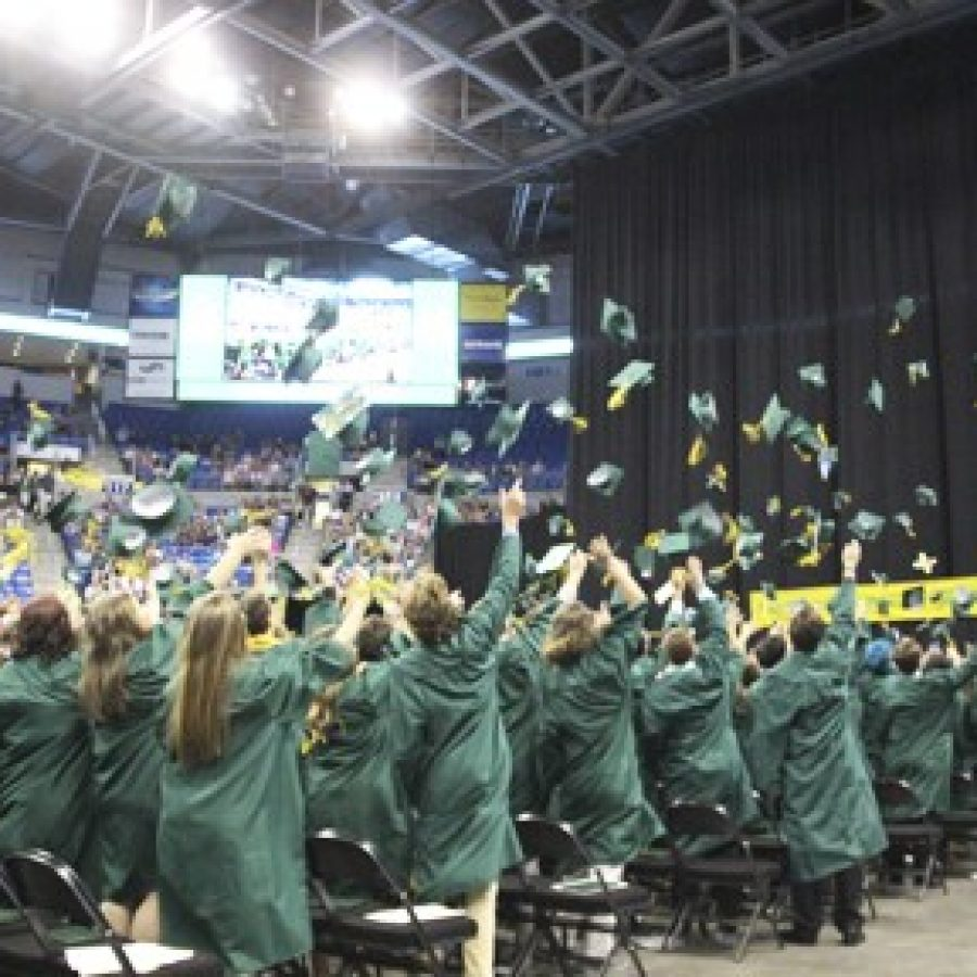 Lindbergh High School Class of 2017 members toss their mortarboards in the air in celebration of their graduation at Chaifetz Arena.