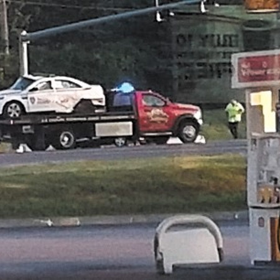 Witness Katelyn Michelle Sterling took this photo of a St. Louis County police car being towed from the scene of a crash on Telegraph Road Sunday.