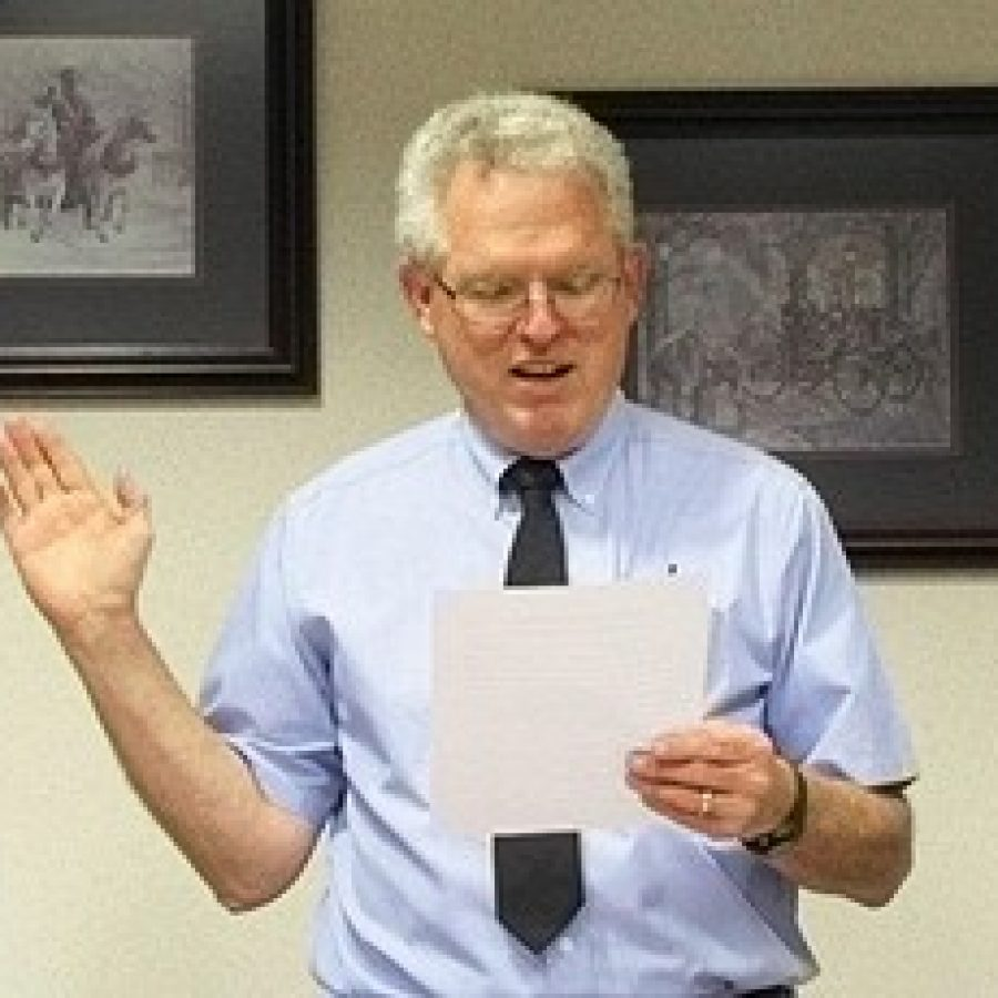 Mehlville Fire Protection District Board of Directors Secretary Ed Ryan takes the oath of office for his second term last week.