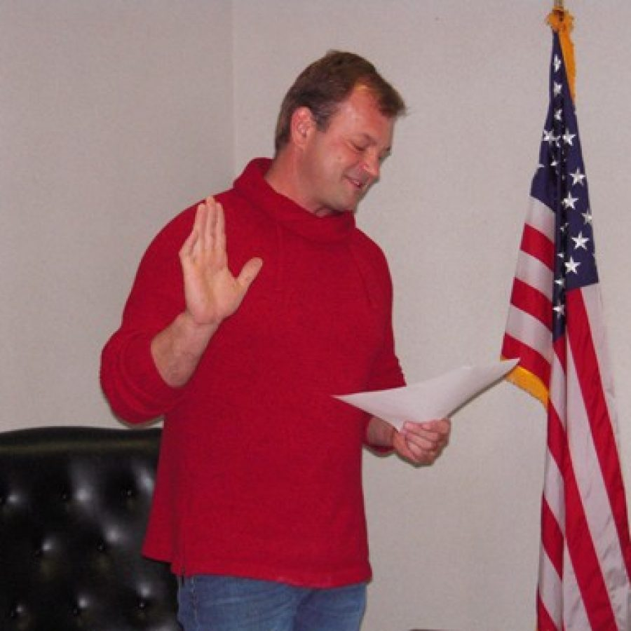 Mehlville Fire Protection District Board of Directors Chairman Aaron Hilmer takes the oath of office last week for a third six-year term on the board. Mike Anthony photo.