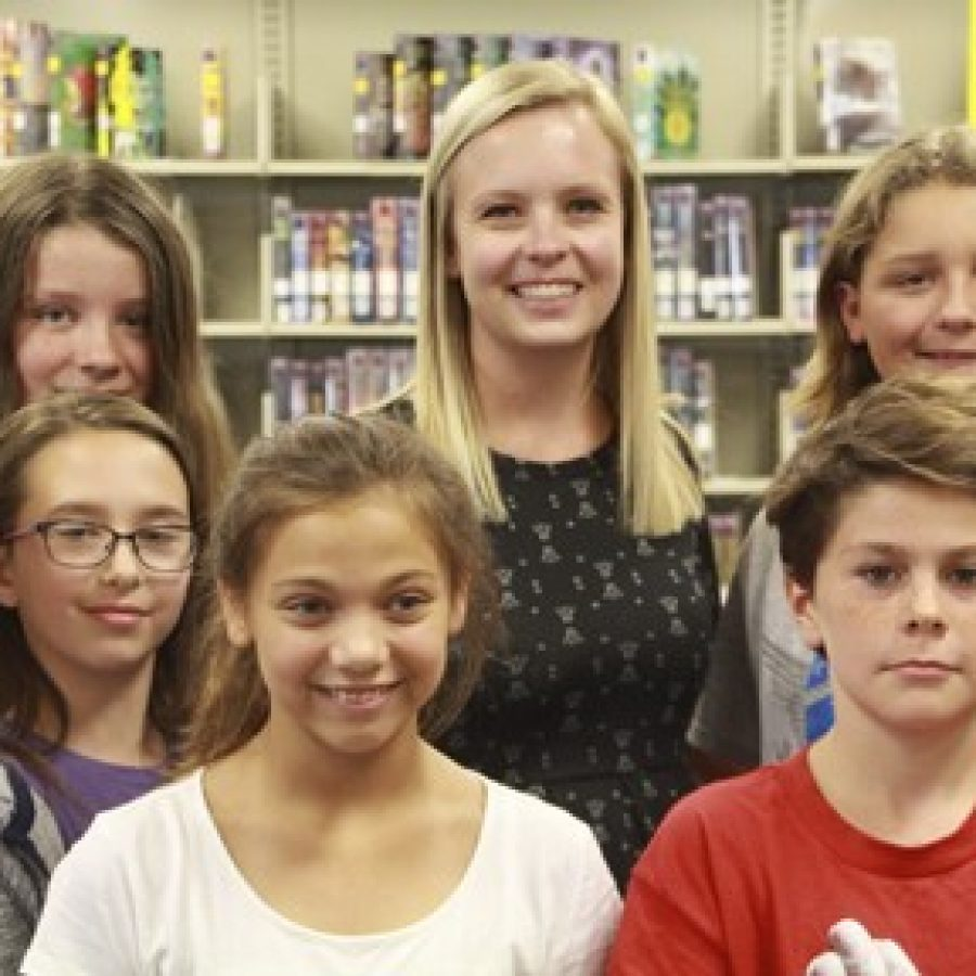 Truman Middle School library media specialist Megan Vallis, center, is one of six 2017-2018 Missouri Teacher of the Year finalists.