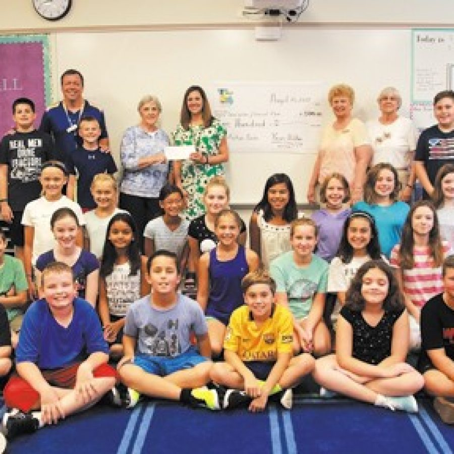 The Missouri Retired Teachers Foundation recently presented Dressel Elementary School fifth grade teacher Sarah Valter, center, green dress, with a \$500 grant to purchase 50 nonfiction books for her classroom library.