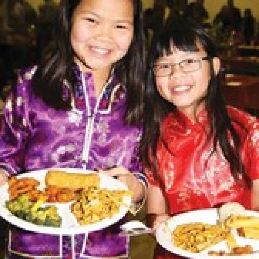 A total of 165 families and friends of the Families With Children From China-St. Louis organization recently gathered at the Crestwood Community Center in Whitecliff Park to celebrate the Chinese New Year. Among those participating in the celebration, from left, are: Charlotte Zink and Michaela Davis.