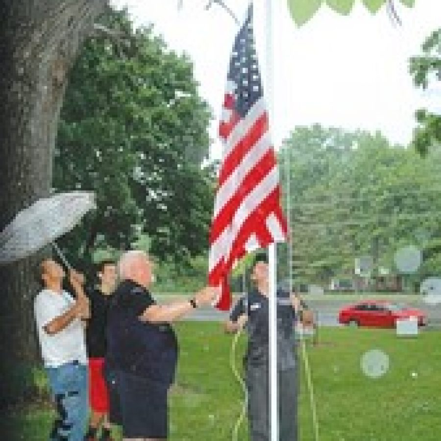The new flagpole at Father Dickson Cemetery