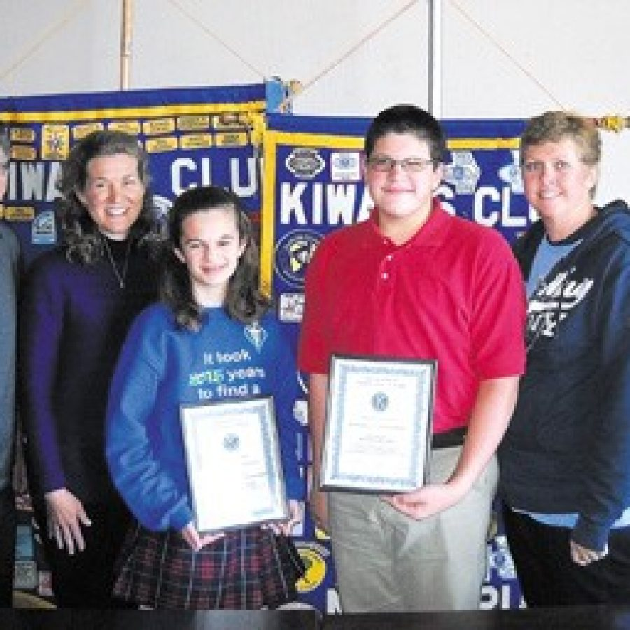 Stephanie Lato of St. Margaret Mary Alacoque Catholic School and Peter Boucher of Bernard Middle School are pictured with their parents, Steve and Laura Lato and Carie and Andre Boucher.
