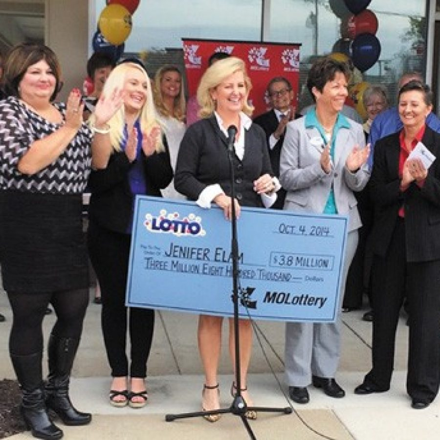 Missouri Lottery Executive Director May Scheve Reardon proclaims real-estate broker Norm Polsky's south county agency 'the luckiest Coldwell Banker office ever' as she presents agent Jenifer Elam with a \$3.8 million check. Pictured, from left, are: Kim DeLapp of Arnold, Jamie Bone of Lemay, Reardon, Elam and Elam's partner, Lea Harthcock.