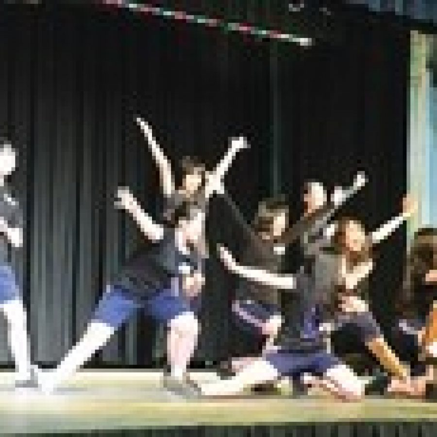 Students from Kyoto, Japan, give a dance presentation for their Notre Dame hosts during their recent visit to St. Louis.