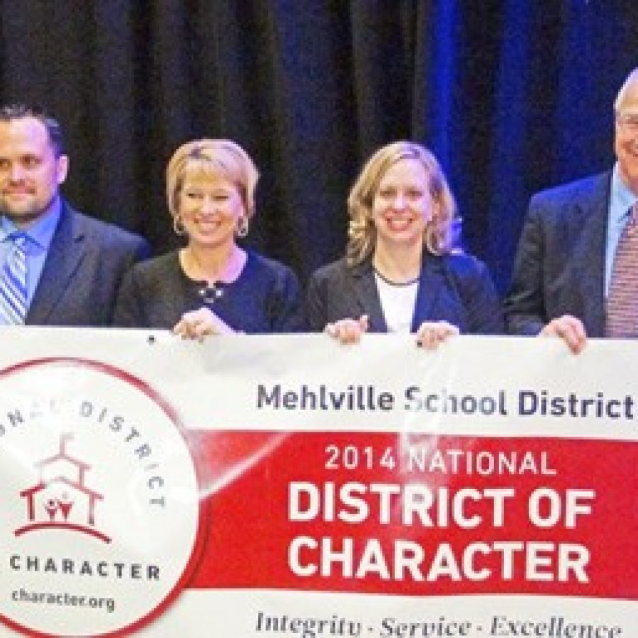 Representatives of the Mehlville School District accept the district's National District of Character award and banner earlier this month. From left: Witzel Alternative Academy Director John DeWalle, Assistant Superintendent-Supervision of Schools Lisa Counts, Blades Elementary administrative intern Laurie Tretter-Larkin and Superintendent Norm Ridder.