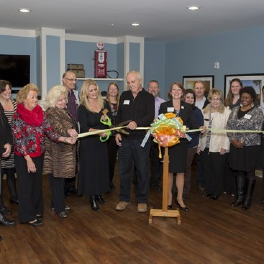 Representatives of National Church Residences and the South County Chamber of Commerce officially cut the ribbon at 6050 Telegraph Road Dec. 9. In the middle cutting the ribbon, from left in the front: South County Chamber of Commerce President Teresa Dorschorst, NCR resident Francis Havrilla, and NCR President of Development Michelle Norris.