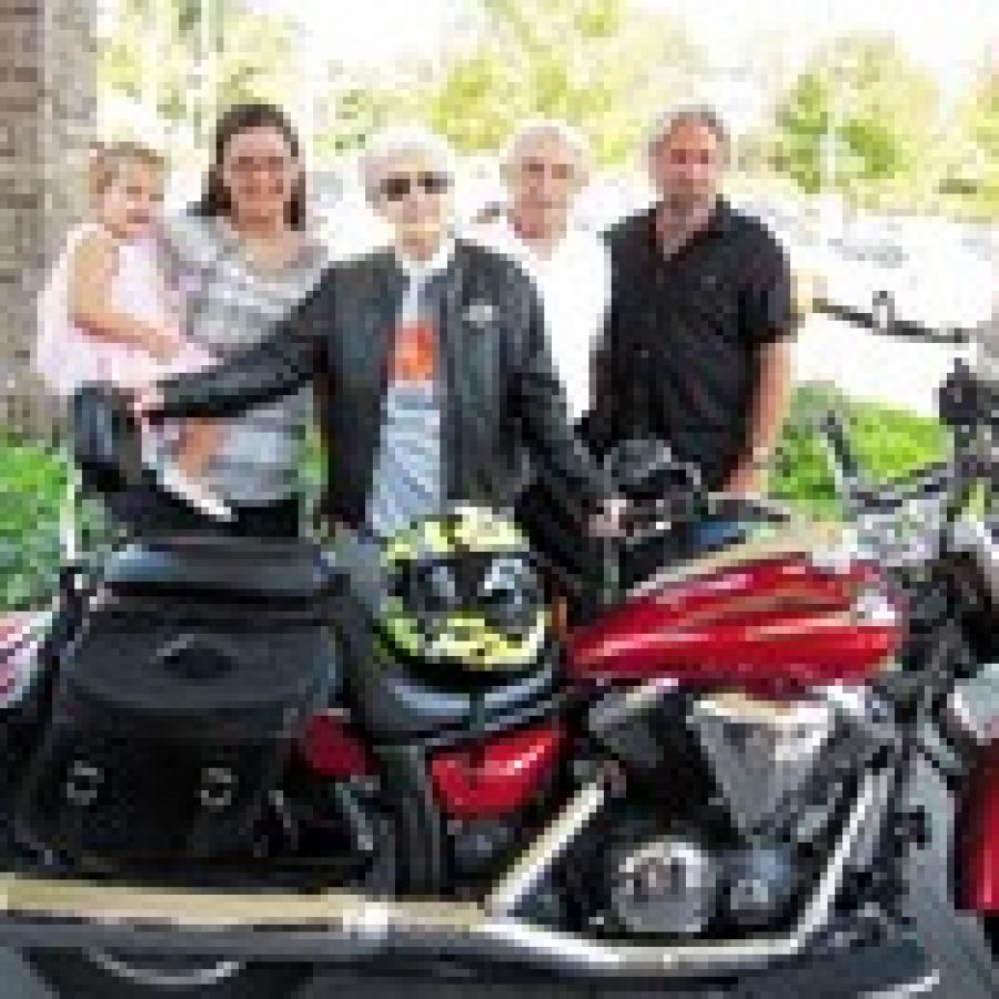 Concord resident Edie Simms, center, is pictured with four generations of her nieces and nephews on her 100th birthday, just before she took her first-ever ride on a motorcycle at Orchid Terrace. Photo by Gloria Lloyd