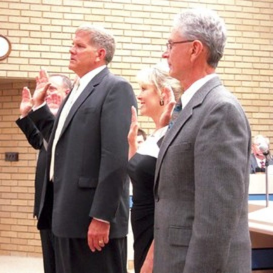 Mayor Mark Furrer is sworn in last April, left, and Ward 2 Alderman Tom Musich is sworn in for another term, right.