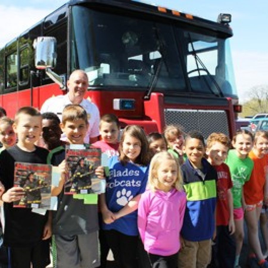 Mehlville Fire Protection District Capt. Kevin Reis is pictured with Blades Elementary School third-graders during his visit at the school.
