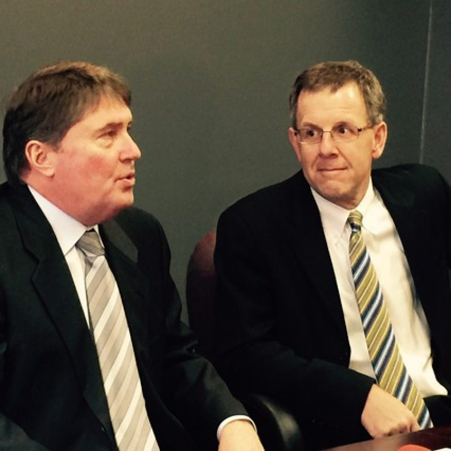 Mayor Mark Furrer's legal team Daniel Bruntrager, left, and Thomas Magee talk to reporters after last week's mistrial.