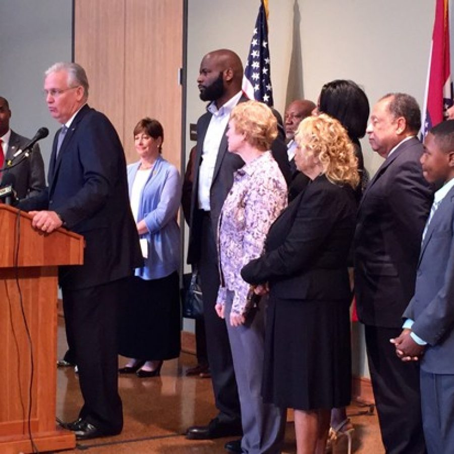 Gov. Jay Nixon, second from left, stands with a sea of state legislators behind him as he announces his veto of the transfer bill at Ritenour High School last week. Among the legislators pictured include, starting with third from right, Rep. Jill Schupp, D-Creve Coeur, Rep. Clem Smith, D-Normandy, and Rep. Tommie Pierson, D-Bellefontaine Neighbors. Second from right is Pierson's intern, frequent County Council speaker Marquis Govan, 12.