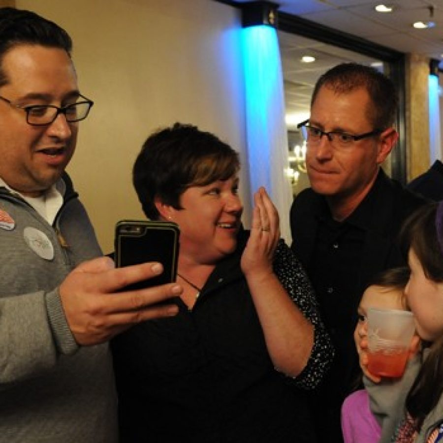 From left, Mark Haefner shows the first wave of Prop R precincts reporting to campaign organizer Kimberly Hanan-West and Assistant Superintendent Jeff Bresler. \