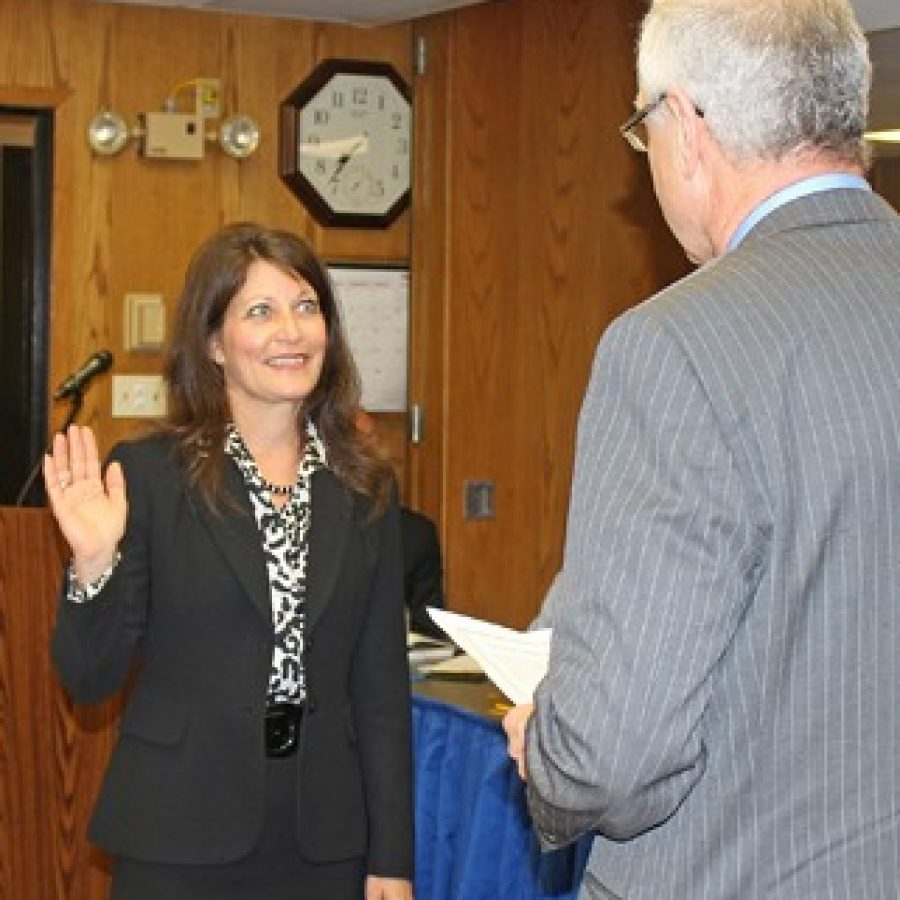 St. Louis University professor and new Mehlville Board of Education member Lisa Dorsey, left, is sworn into office by Superintendent Norm Ridder.