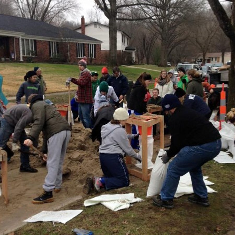 In a picture Sunset Hills Mayor Mark Furrer posted to his Facebook page, Lindbergh students and Sunset Hills residents fill 6,000 sandbags at Forest View Subdivision Wednesday.