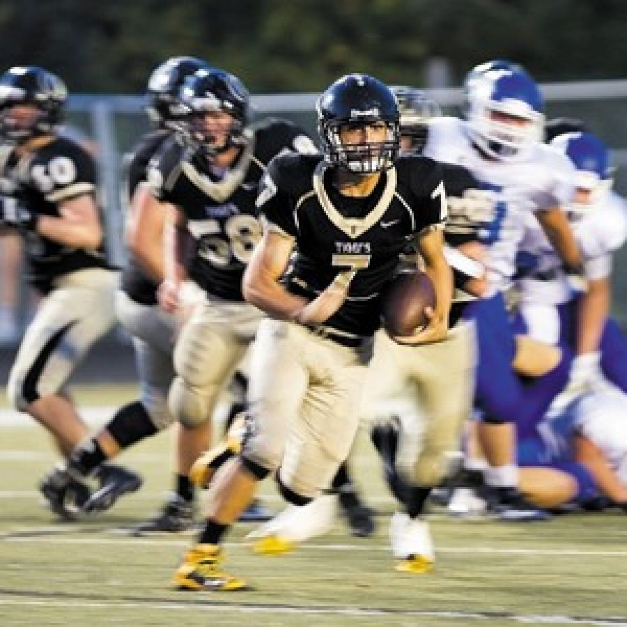 Oakville High quarterback Bailey Vuylsteke, No. 7, rushes in Friday night's 28-7 victory over Northwest. The 3-2 Tigers will face 3-2 Lafayette this week.Megan LeFaivre-Zimmerman photo