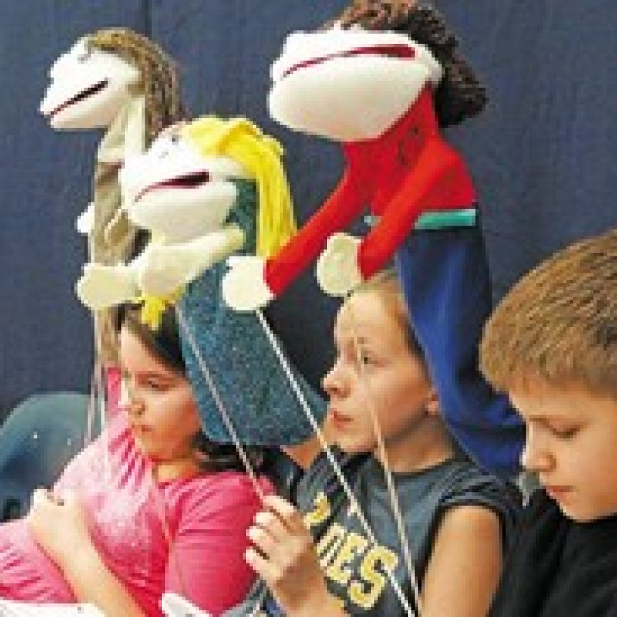Fifth-grade students in Mehlville School District's gifted program, Supplementary Teaching Resources for Educationally Talented Children, or STRETCH, worked for weeks on a play demonstrating the benefits of service. STRETCH students, pictured, from left, are: Samantha Galayda, Josie Fisher and Alex Mittendorf.