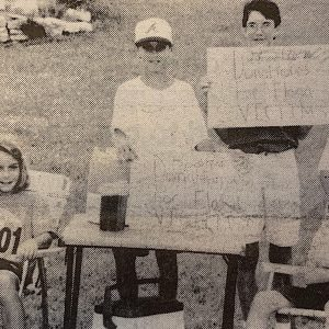 From left, Jamie, 10, and Josh Standford, 10, Sean Steller, 13, Dusty Strettmann, 12, and Matt Steller, 9, raised $250 for flood victims with a lemonade stand near their homes on Hawkins-Such Road.