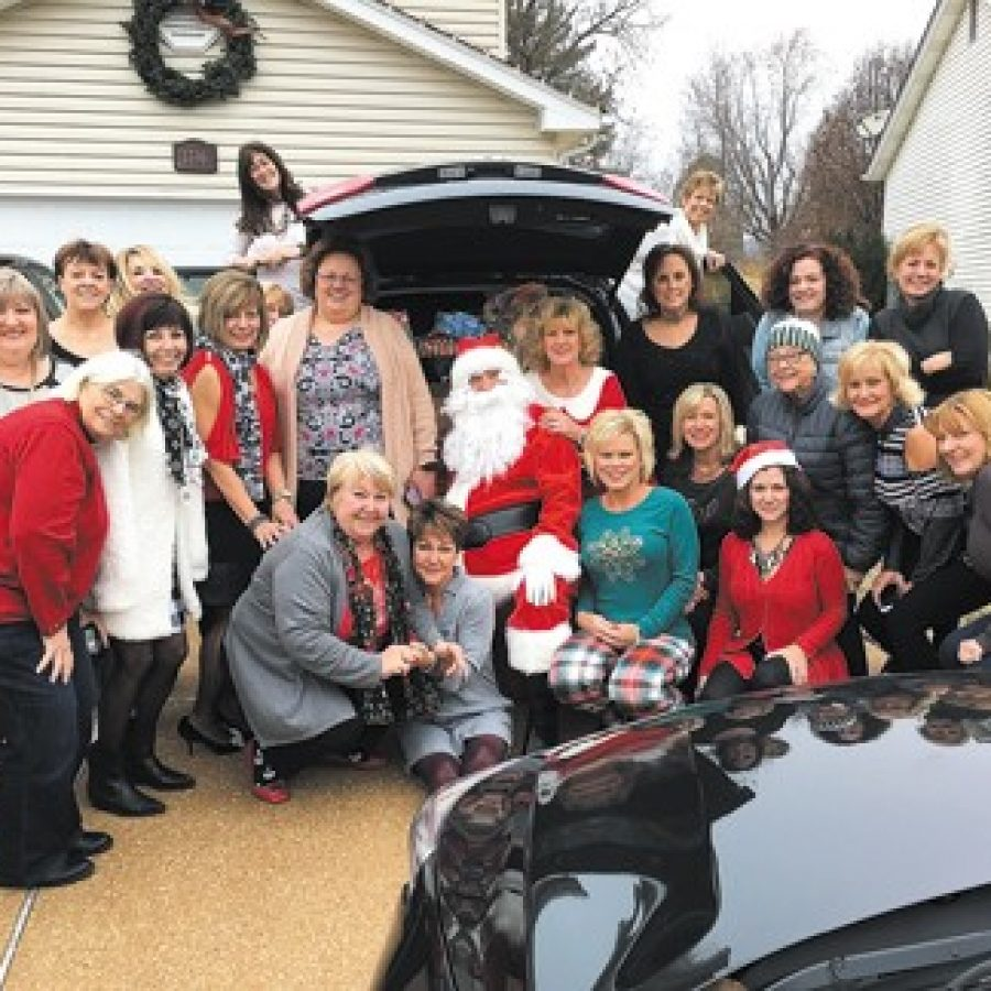 Members of Mehlville's Caring Community Project attending their annual breakfast Saturday, from left, are: Marge Mesplay, Kata Lozina, Christy Franklin, Barb Tate, Tina Summers, Shirley Haegele, Geri Peters, Gina Ravens, on car, Debbie Shelby, Heather Flaherty, Patti Kappel, Sharon Beye, Santa, Terry Beye, Cindy Compton, Rhonda Houska, Linda Berkbigler, Cheryl Thomas, Lisa Mohr, Jeanne Kadane, Martha Perry, Ellen Keen and Tookie Carlson.