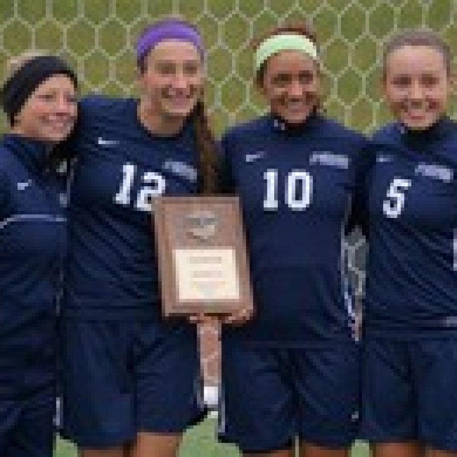 Four south county members of the St. Louis Community College Archers soccer team, from left, Colleen McCommish, Annie Miskovic, Katie Rapisardo and Lauren Guerrero, are shown after winning the district championship.