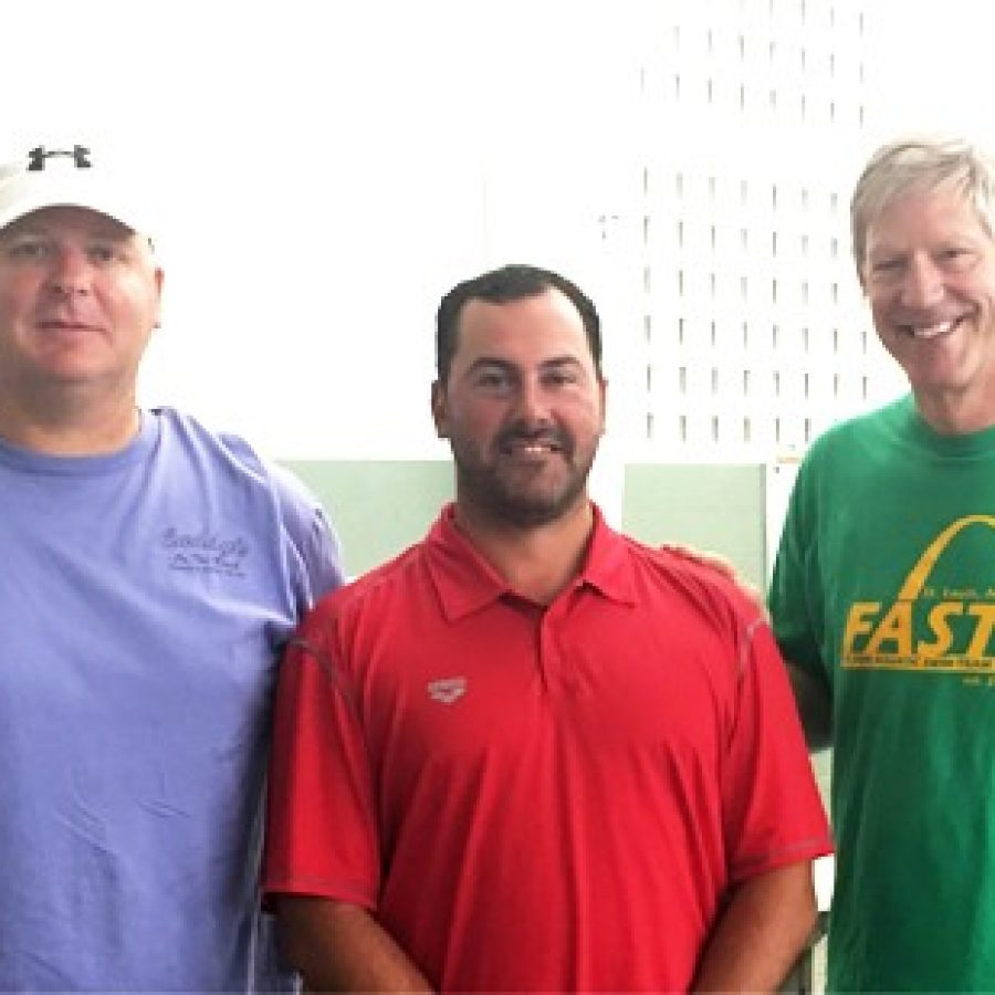 Raz Cuparencu, center, is the new national team coach for the Flyers Aquatic Swim Team, or FAST. He is pictured with Duane Punnewaert, left, president of the FAST board, and Jim Halliburton,  FAST head coach.