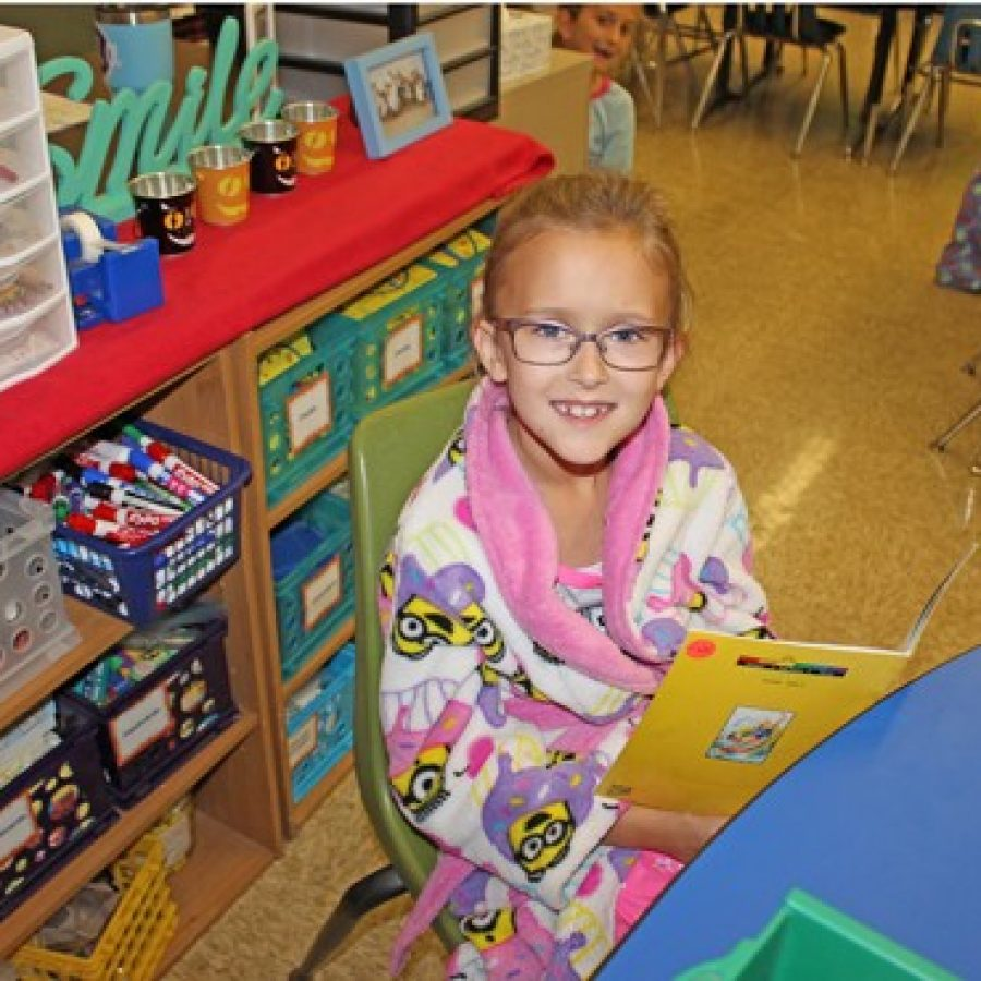 A student at Point Elementary attended school in her robe Wednesday to donate to BackStoppers, an idea spearheaded by students at Oakville Elementary that spread to the rest of Mehlville's elementary schools.
