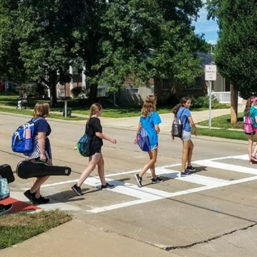Above, Truman Middle School students use the new crosswalks.
