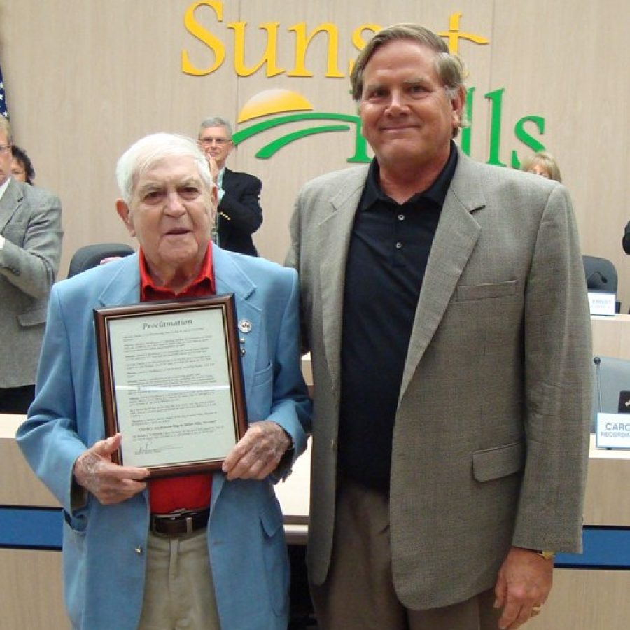 Charles J. Stockhausen, left, is honored by then-Sunset Hills Mayor Mark Furrer with 'Charles Julius Stockhausen Day.'
