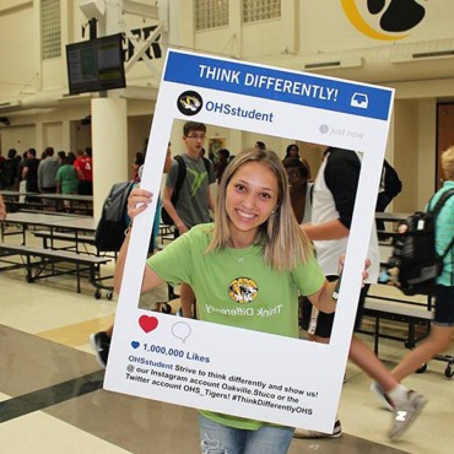 An Oakville High School student poses for the Student Council's Instagram campaign \