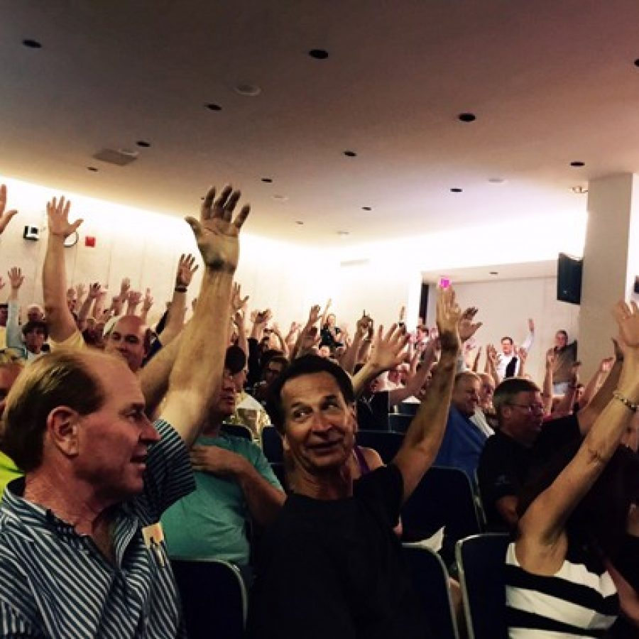 Neighbors of the proposed apartments raise their hands in opposition at the June 20 Planning Commission public hearing on the project.