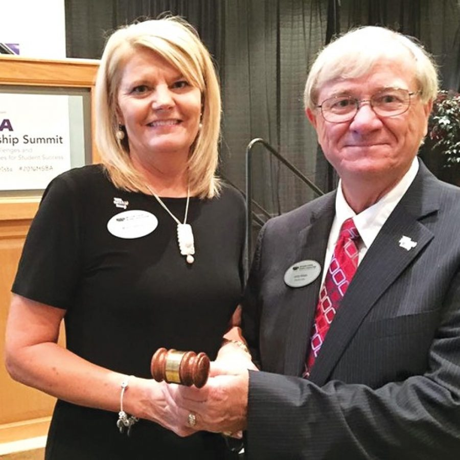 New Missouri School Boards' Association President Larry Felton, a member of the Mehlville Board of Education, accepts the gavel from past President Mona Coleman of Bolivar during the MSBA Leadership Summit at Tan-Tar-A in Lake of the Ozarks.