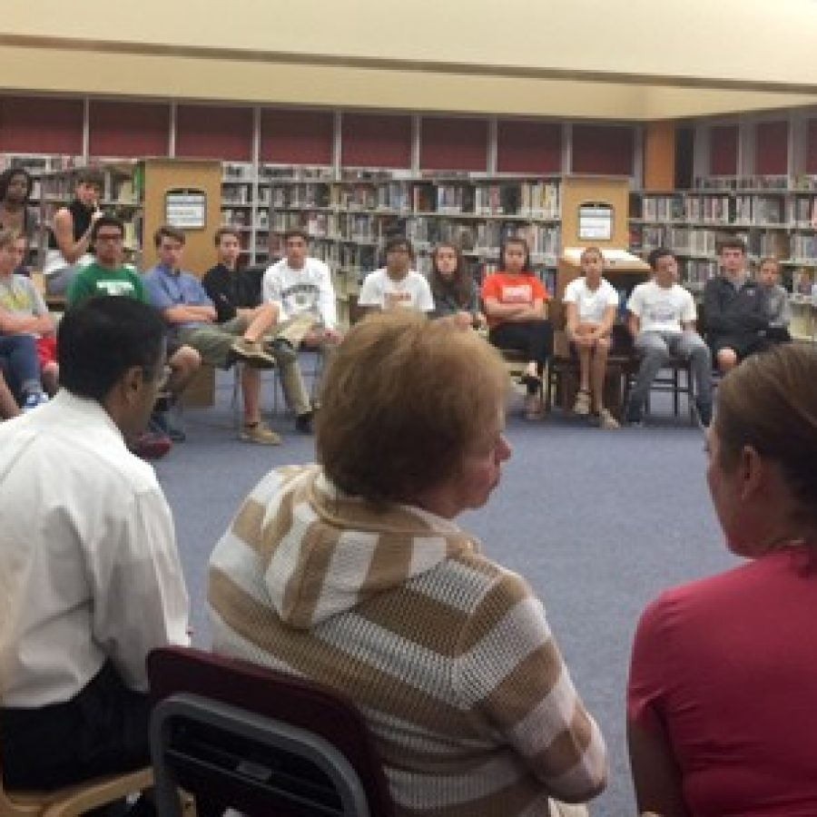 Mehlville board members, forefront, talk to the Mehlville Student Council last year about block scheduling and Prop R.