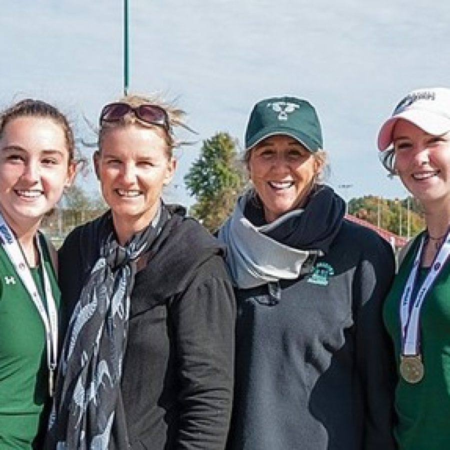 Lindbergh High School sisters Kat, far left, and Alex, far right, Rosenberger celebrate their Class 2 State Doubles Championship last year with their mother, Noel Quevreaux, middle left, and Shannon Cook. Quevreaux and Cook teamed up to win Lindbergh's last doubles tennis title in 1984. The Rosenberger sisters finished sixth at state this year.