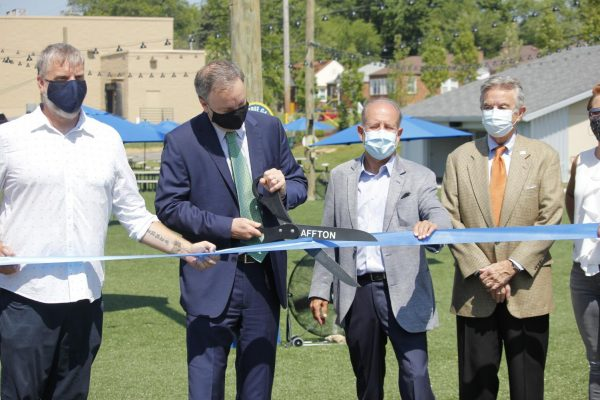 St. Louis County Executive Sam Page attends the ribbon cutting ceremony at 9 Mile Garden, a food truck garden in Affton that claims to be the first in the state. The food truck garden officially opened July 3.