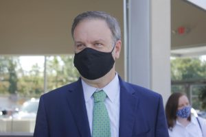 County Executive Sam Page appears in a mask at the July 2020 ribbon cutting for 9 Mile Garden food truck plaza in Affton.