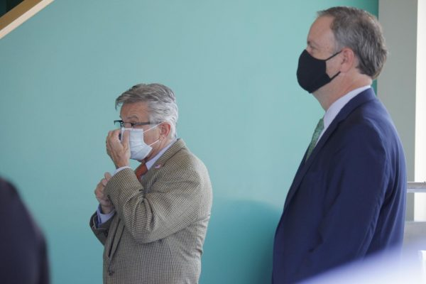Both County Executive Sam Page and 6th District County Councilman Ernie Trakas don masks at the official ribbon-cutting at 9 Mile Garden in Affton July 9.