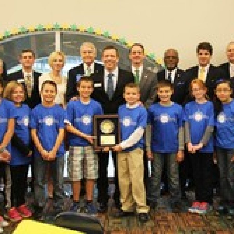 State and local officials celebrate Sappington Elementary School's National Blue Ribbon School Award on Nov. 20. Pictured with Sappington fifth-grade ambassadors, from left, are: Board of Education member and Rep. Vicki Englund; Sen. Eric Schmitt; County Councilman Pat Dolan; Green Park Ward 1 Alderman Anthony Pousosa; Rep. Genise Montecillo; retired Sappington teacher Barry Bierwirth; Principal Craig Hamby; Sen. Scott Sifton; County Executive Charlie Dooley; Brecht Mulvihill, representing U.S. Rep. Ann Wagner; Superintendent Jim Simpson; Brendan Fahey, representing U.S. Sen. Claire McCaskill; and Assistant Principal Angie Moehlmann.