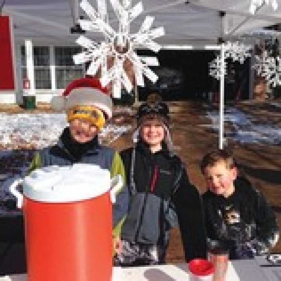 Three brothers who attend Kennerly Elementary School recently hosted a hot cocoa stand that raised more than \$1,500 for Assumption Parish's St. Vincent DePaul Society. Pictured, from left, are: Brock, Chase and Drew Barger, who are in fourth grade, third grade and kindergarten, respectively.