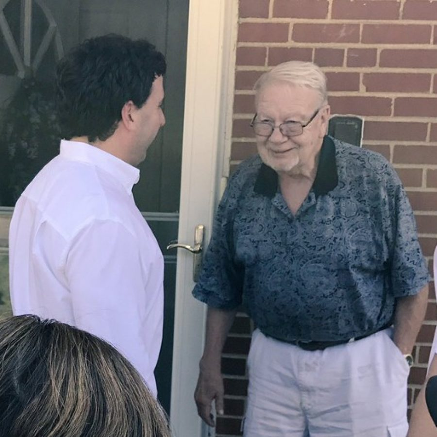 County Executive Steve Stenger, left, talks with an Affton man as Stenger went door-to-door with firefighters Thursday.