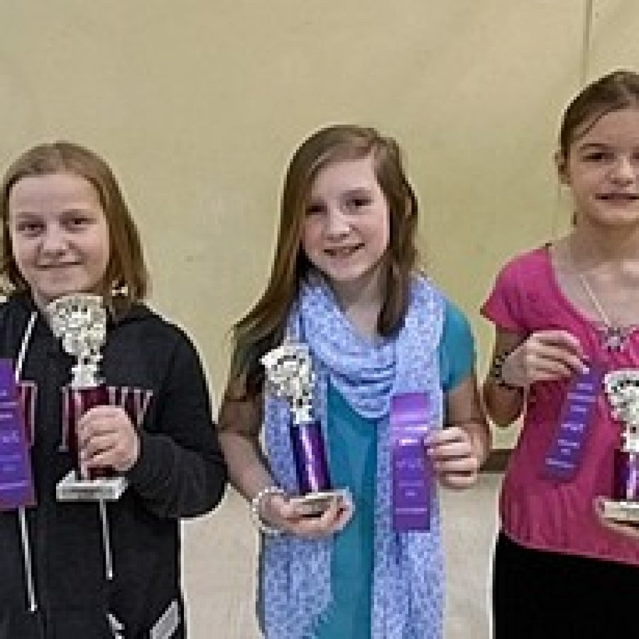 Kaitlyn Pluff, fifth-grade, left, won the Gotsch Intermediate School Spelling Bee and will go on to compete in the St. Louis Post-Dispatch 2013 Spelling Bee Semifinal Competition in March. Kim Welch, fourth-grade, center, came in second, and Anna Bohnert, fourth-grade, came in third.