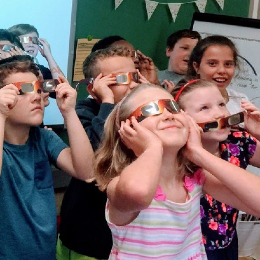 Gotsch Intermediate School third-graders in the Affton School District practice wearing their eclipse glasses on the second day of school Thursday.