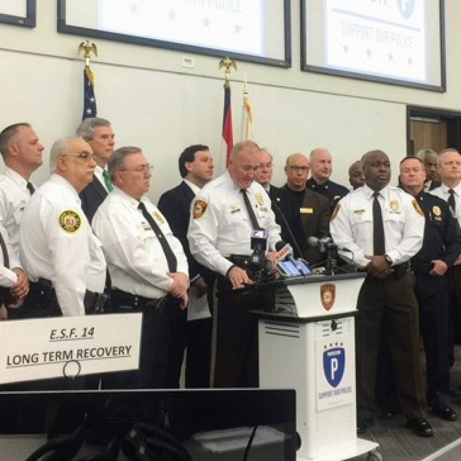 Chief Jon Belmar speaks at the Prop P kickoff event last week, surrounded by police officers and officials including county Prosecuting Attorney Robert McCulloch, County Executive Steve Stenger and Deputy Chief Ken Cox.