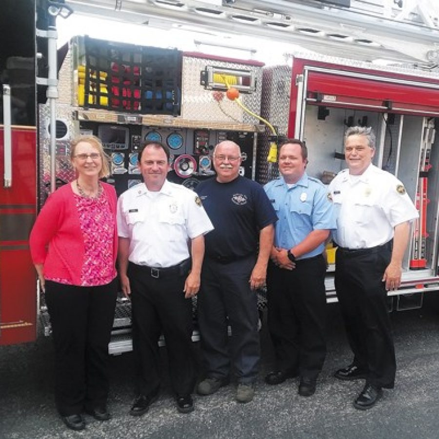 The Mehlville Fire Protection District recently took delivery of a new 75-foot aerial ladder truck. Pictured, from left, are: Board of Directors Treasurer Bonnie Stegman, Chief Brian Hendricks, Chief Mechanic Ken Wenk, Pvt. Mike Mueller and Deputy Chief Dan Furrer. Furrer, Wenk and Mueller serve on the district's Apparatus Committee. Mike Anthony photo